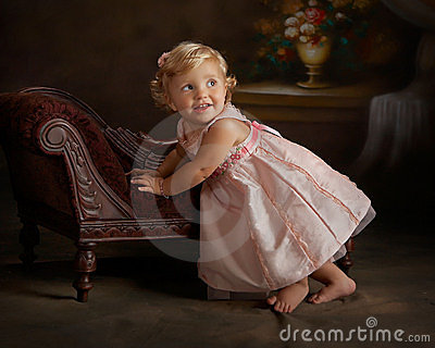 portrait of little girl in pink dress