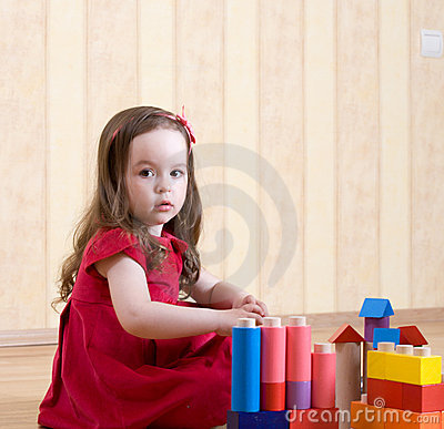 Portrait of a little girl playing with toys