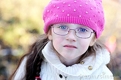 A portrait of little girl wearing pink cap