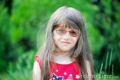 Portrait of little girl wearing red dress