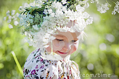 Portrait of little girl with wreath