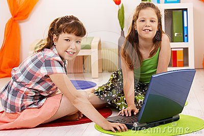 Portrait of little girls with laptop
