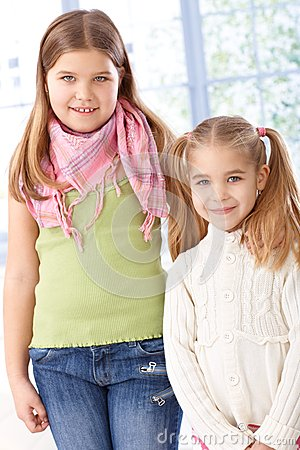 Portrait of little sisters smiling