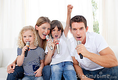 Portrait of a lively family singing Stock Photo