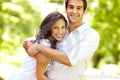 Portrait of love couple embracing in park