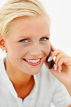 Portrait of a lovely blond speaking on  cellphone