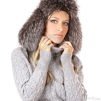 Portrait of a lovely blond in a winter hat