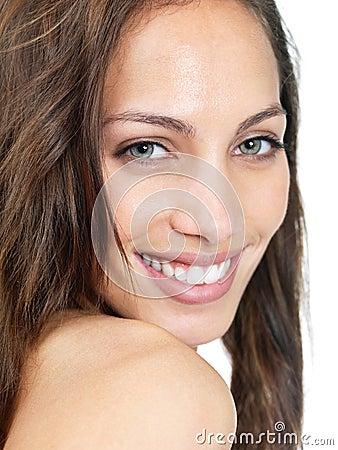 Portrait of a lovely female smiling against white
