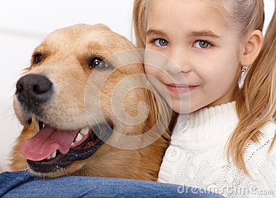 Portrait of lovely little girl and dog