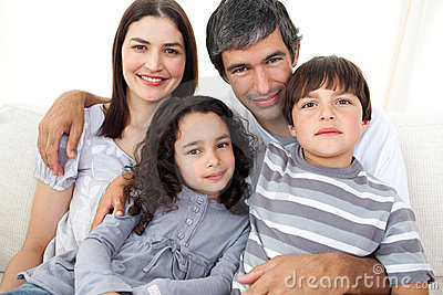 Portrait of a loving family sitting on a sofa