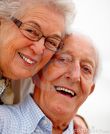 Portrait of lovingly smiling old couple
