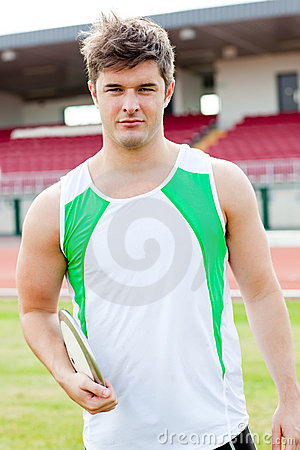 Portrait of a male athlete holding a discus