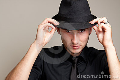 Portrait of male model in a hat