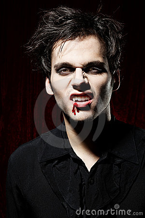 Portrait of a male vampire showing his teeth
