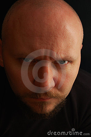 Portrait of man with angry look