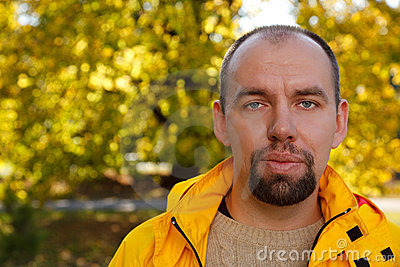 Portrait of man with beard in autumn park