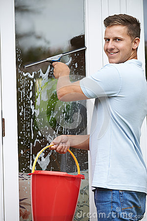 Portrait of man cleaning house windows stock photo image 55935996 for Cleaning exterior house windows