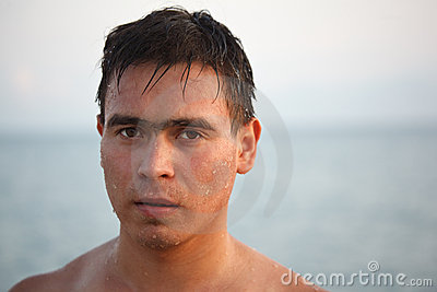 Portrait of man come up from water