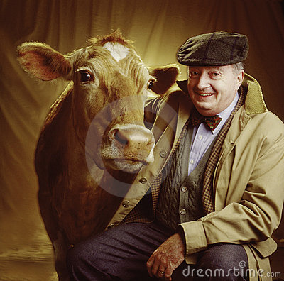 Portrait of man with cow