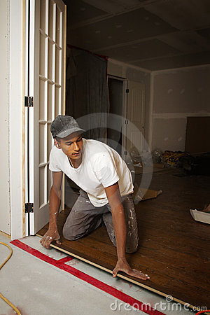 Portrait of a man doing flooring