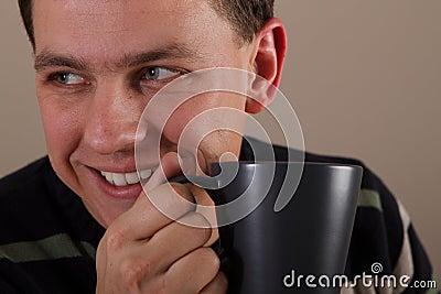 Portrait of man drinking hot beverage
