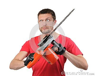 Portrait man with electric saw