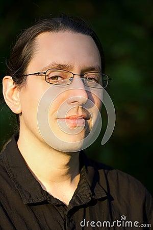 Portrait of Man in Glasses