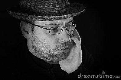 Portrait of man with hat and beard sad looking