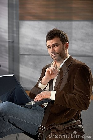Portrait of man with laptop