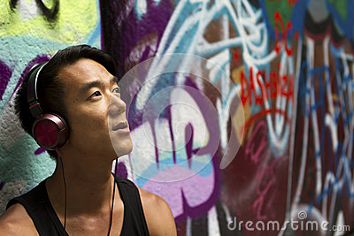 Portrait of a man listening to music on his headphones