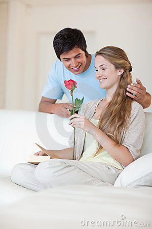 Portrait of a man offering a rose to his fiance