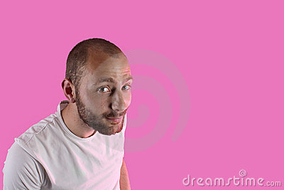 Portrait of a man on a pink background