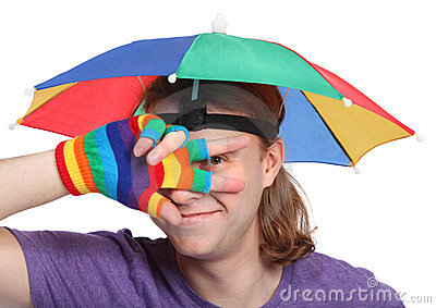 Portrait of man with rainbow hat umbrella