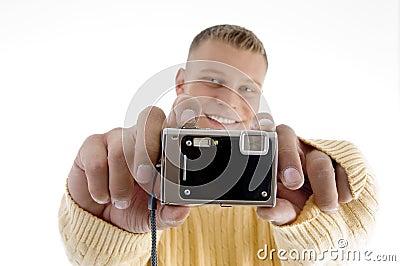 Portrait of man showing camera