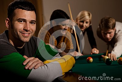 Portrait of man at snooker table