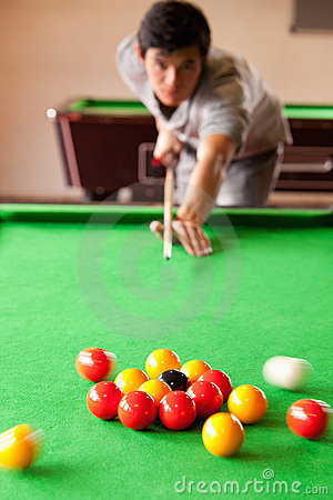 Portrait of a man starting a pool game