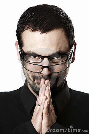 Portrait of man with two glasses looking straight.