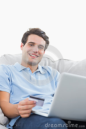 Portrait of a man using his credit card to buy online