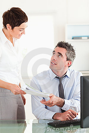 Portrait of a manager receiving a document