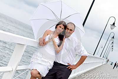 Portrait of married couple at Baltic sea