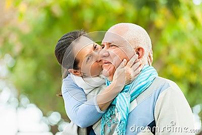 Portrait of mature couple in autumn park