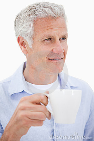 Portrait of a mature man drinking tea