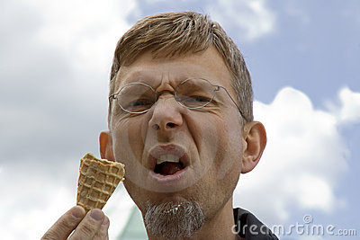 Portrait of a mature man with ice cream cone