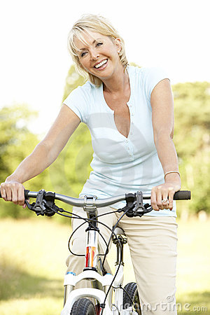 Portrait of mature woman riding cycle in countrysi