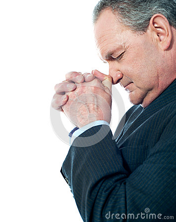 Portrait of matured businessman praying