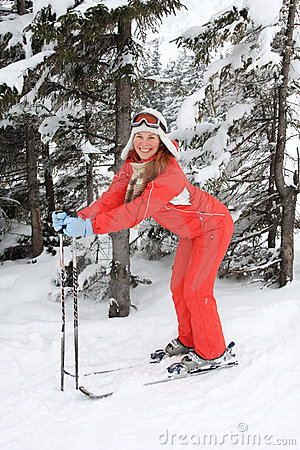 Portrait of merry young woman of skier