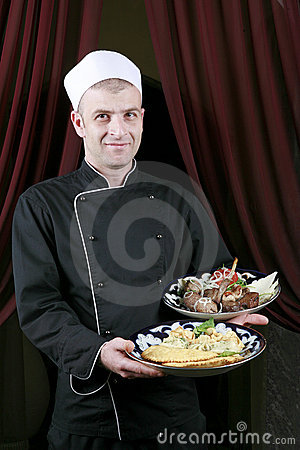 Portrait mid adult male chef in kitchen present
