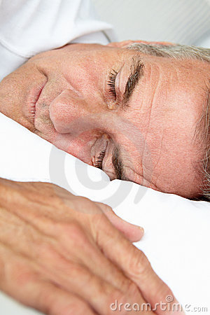 Portrait of mid age man sleeping