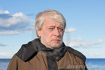 Portrait of middle-aged man at the sea.