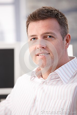 Portrait of middle-aged office worker smiling